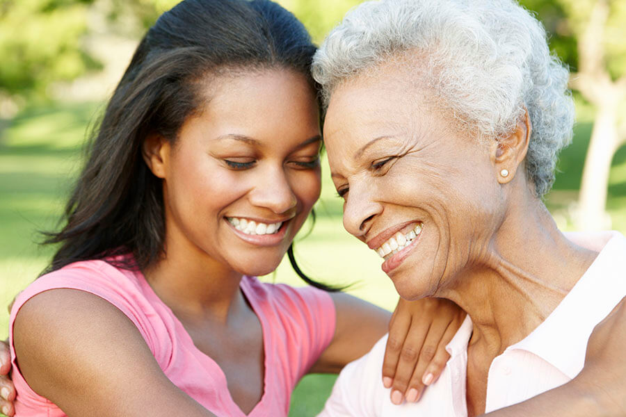 Image of a younger woman and her elderly mother embracing