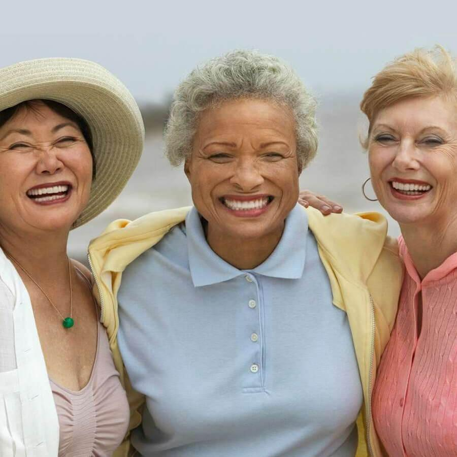 Three older women laughing