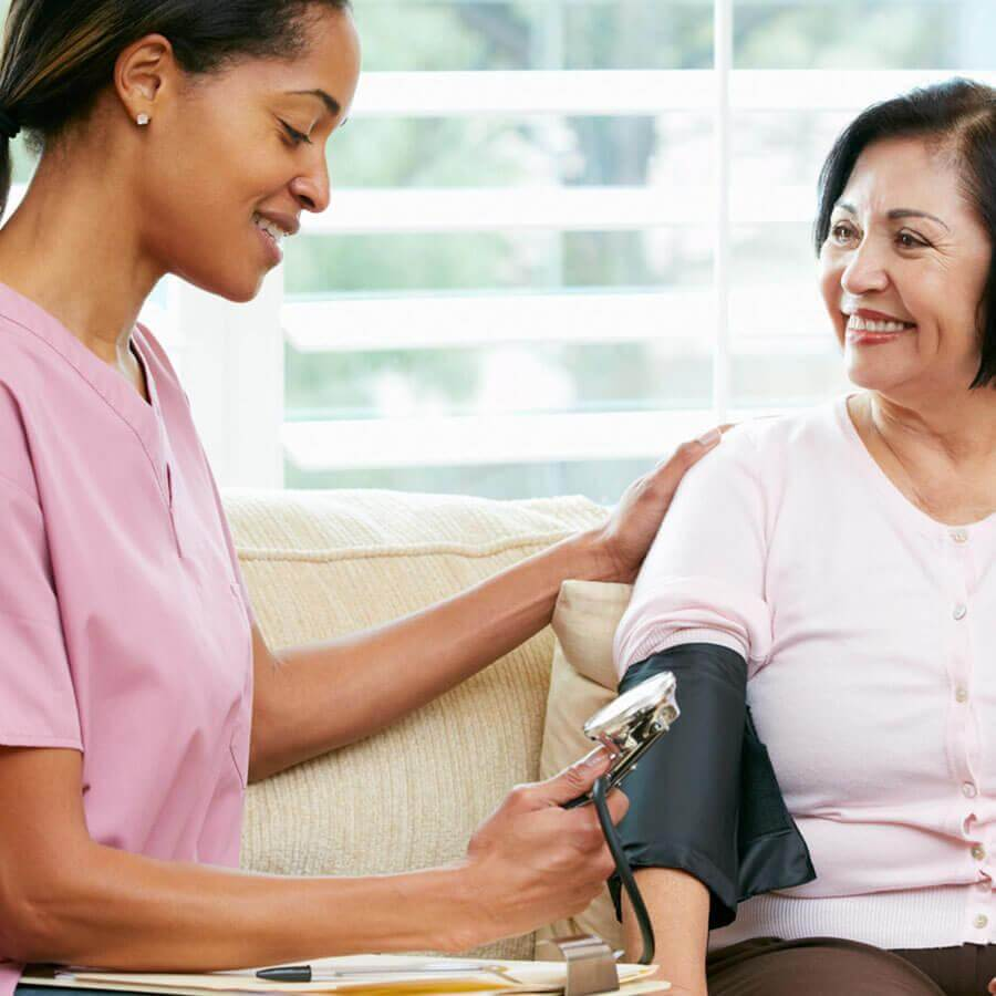 Woman receiving a blood pressure test