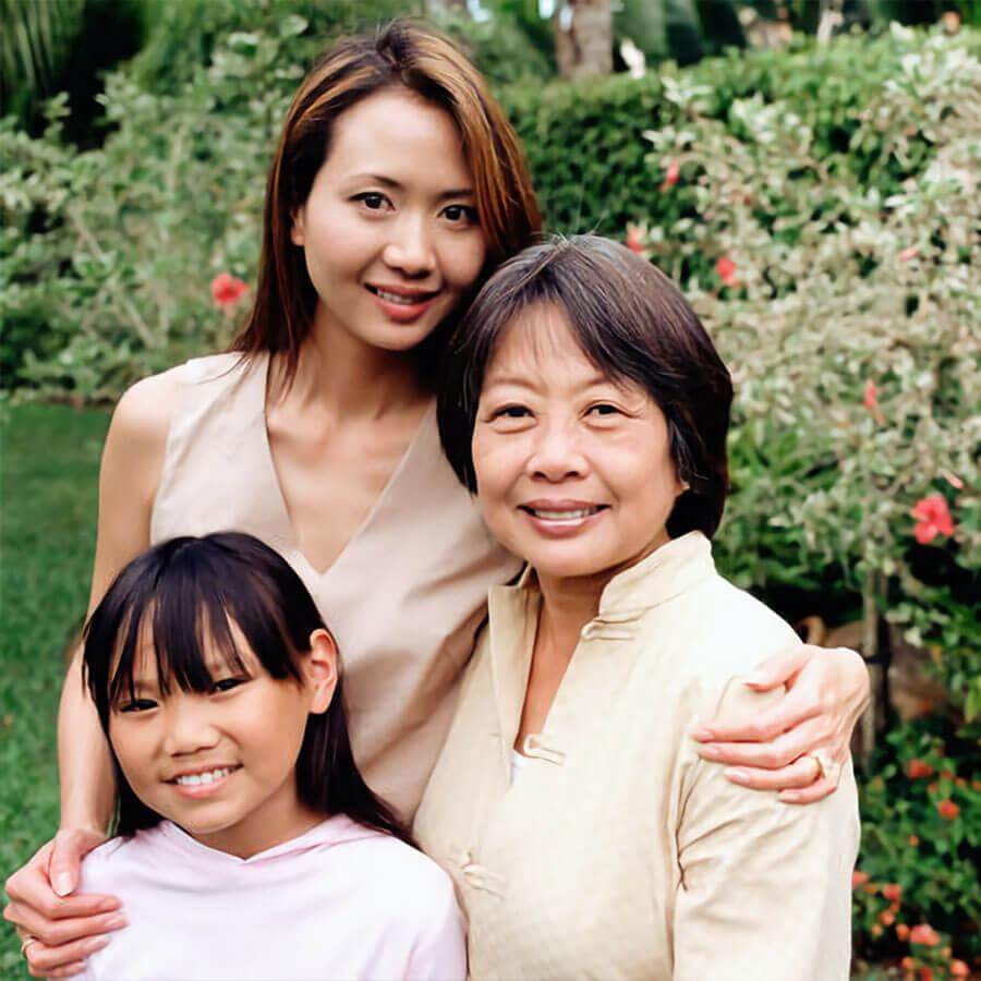 An older woman, an adult woman, and a child
