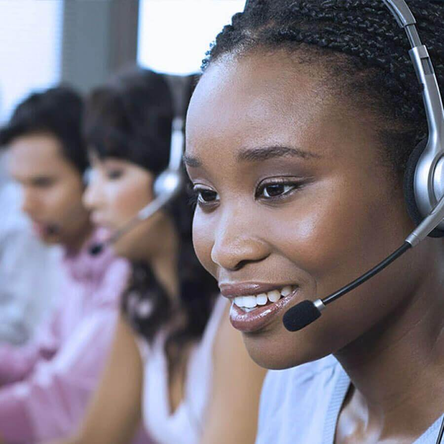 Woman and others working at a call center
