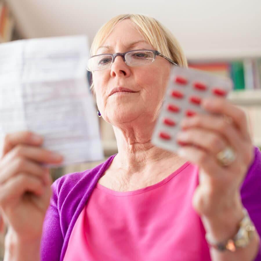 Woman reading a prescription