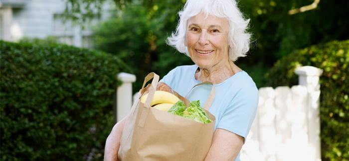 Older woman carrying groceries