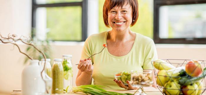 Woman eating a colorful salad