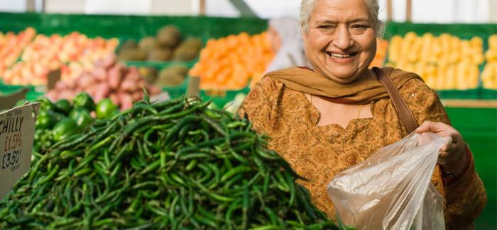 Woman selecting peppers at a market