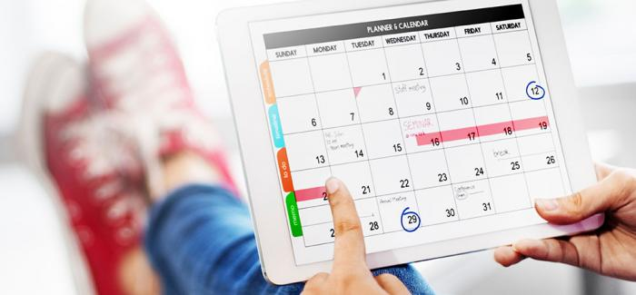 A computer tablet with a calendar
