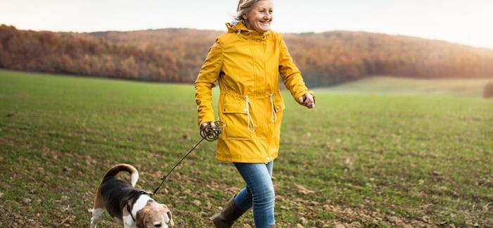 Woman running outdoors with her dog
