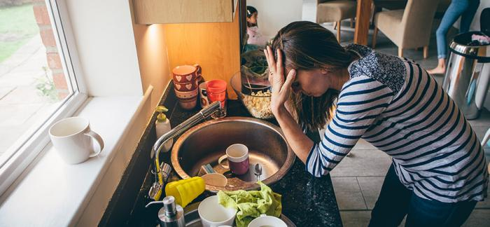 Image of a woman appearing stressed out