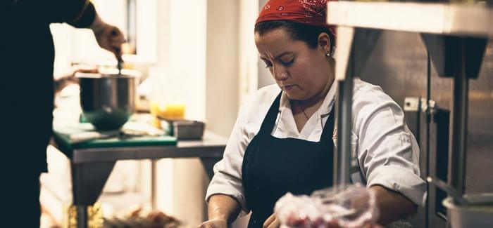 Woman working as a chef in a bakery