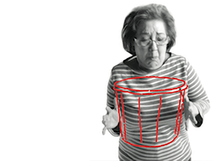 Photo of a woman experiencing nausea (feeling sick to the stomach), illustrated by a super imposed sketch of a bucket into which she appears to be about to vomit.