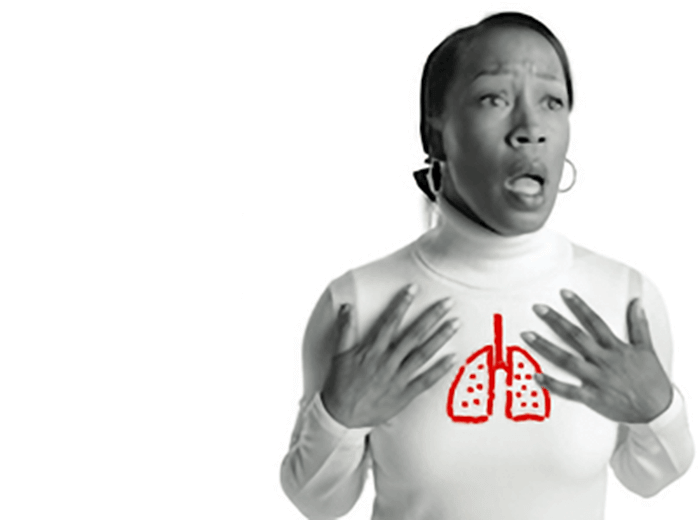 Photo of a woman experiencing shortness of breath, illustrated by a super imposed sketch of disproportionately shrunken lungs.