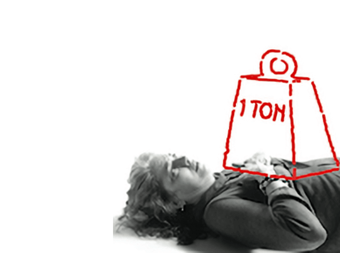 Photo of a woman experiencing chest pain or discomfort, illustrated by a super imposed sketch of a large block labelled '1 ton' on her chest.