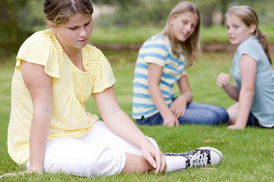 Girl being bullied by her peers
