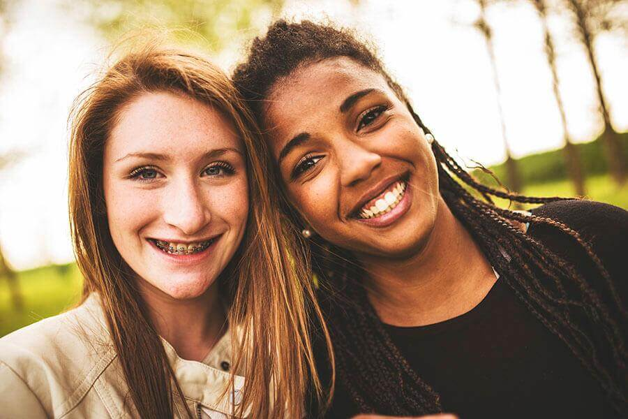 Image of two girls smiling.