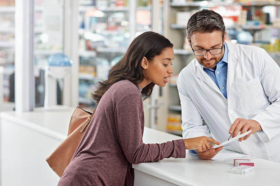 Woman looking at a prescription with a doctor