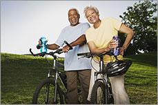 An older couple going bicycle riding.