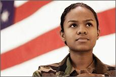 A female veteran in front of the U.S. flag